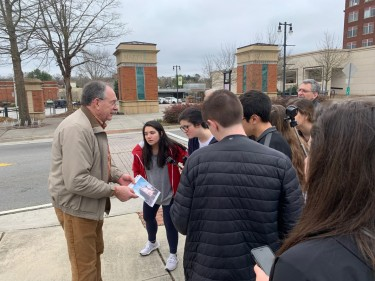 A Maryville resident explains to students the history of Preservation Plaza. Katie Headrick Taylor